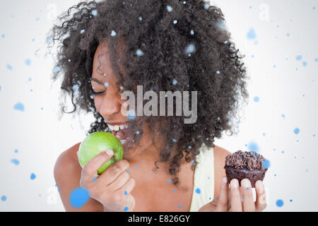 Young woman going to eat a delicious green apple - Stock Photo