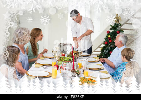Composite image of father serving christmas meal to family - Stock Photo