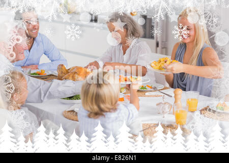 Composite image of happy family eating the thanksgiving dinner - Stock Photo