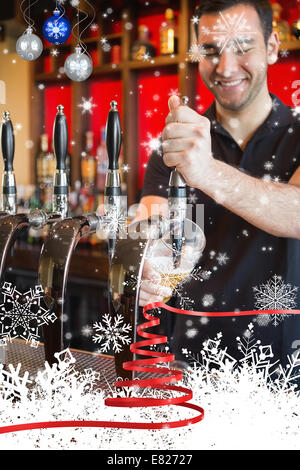 Handsome barkeeper pulling a pint of beer - Stock Photo