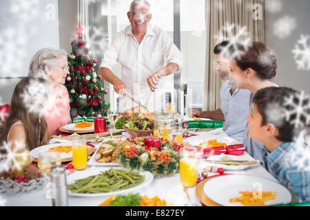 Grandmother Serving Food To Family At Christmas Dinner