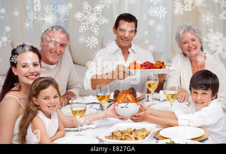 Grandparents parents and children having a family dinner - Stock Photo