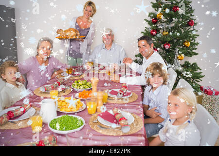 Composite image of mother bringing turkey to dinner table - Stock Photo