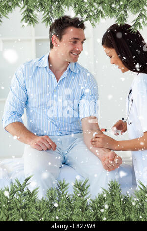 Composite image of a patient getting vaccinate - Stock Photo