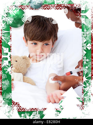 Composite image of sick little boy receiving an injection - Stock Photo