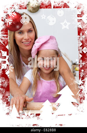 Composite image of mother and daughter baking in the kitchen - Stock Photo