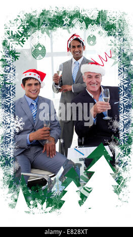 Composite image of confident businessmen wearing novelty christmas hat - Stock Photo