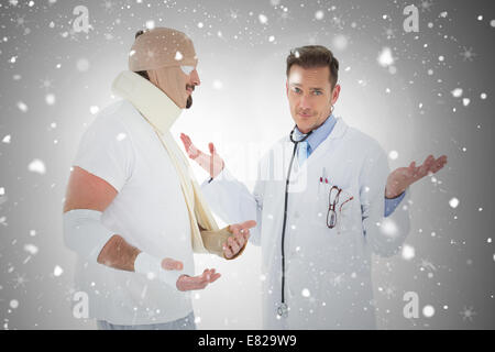 Portrait of a doctor with patient tied up in bandage - Stock Photo
