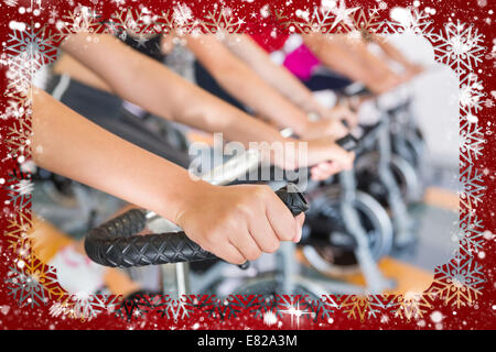 Spin class working out in a row - Stock Photo