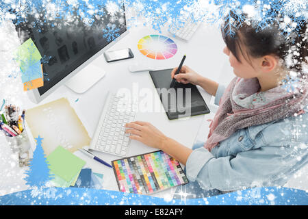 Artist drawing something on graphic tablet at office - Stock Photo