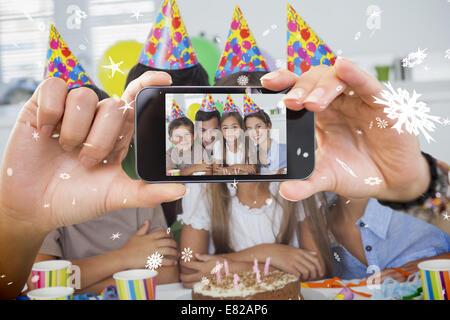 Hand holding smartphone showing photo - Stock Photo