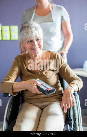 Development of housing for Persons with Reduced Mobility, Here, Using a remote controlling electrical equipment - Stock Photo