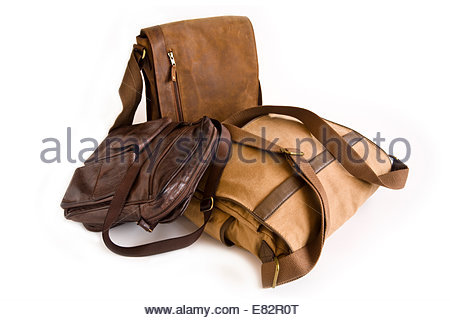 Three brown leather and canvas men's shoulder bags - Stock Photo