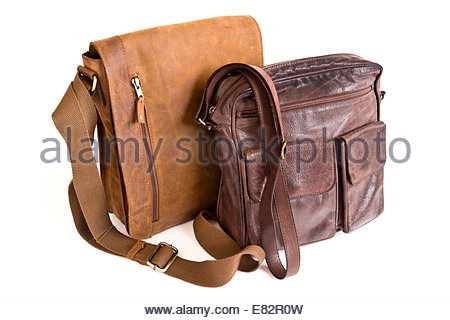 Two brown leather man bags. - Stock Photo