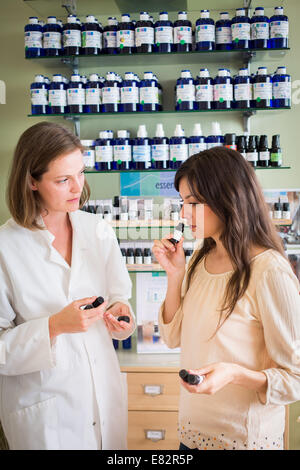 Woman shopping for aromatherapy products in pharmacy. - Stock Photo