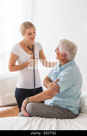 Man discussing with health professional. - Stock Photo