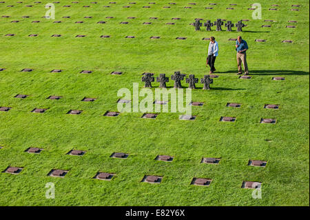 German visitors looking at graves at the La Cambe Second World War military cemetery, Lower Normandy, France - Stock Photo