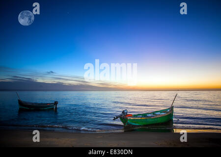 a fishboat in naila lagoon on sunset - Stock Photo