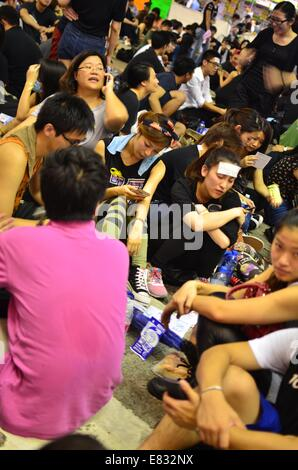 Hong Kong. 29th Sep, 2014. Hong Kong Protests: Some protestors rest as thousands of young people wearing black T - Stock Photo