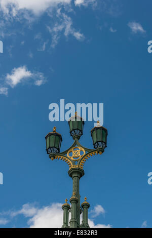 Ornate Victorian street lamps on Westminster Bridge in London - Stock Photo