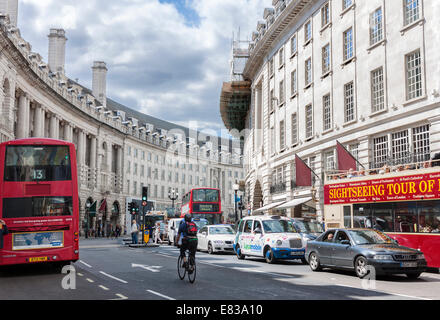 Typical double decker bus in Regent street  in London. Regent Street is one of the major shopping streets in Europe - Stock Photo