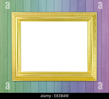 blank golden frame on color wood wall background - Stock Photo