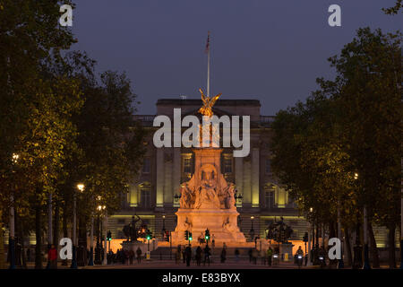 This image shows the Victoria Memorial at the top of The Mall in London, England with Buckingham Palace behind. - Stock Photo