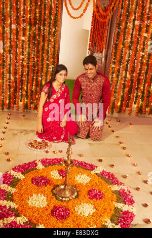 indian Diwali Festival diya worship - Stock Photo