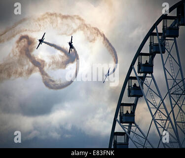 GB - DEVON: Blades Aerobatic Display Team performing over Torquay's Riviera Wheel - Stock Photo