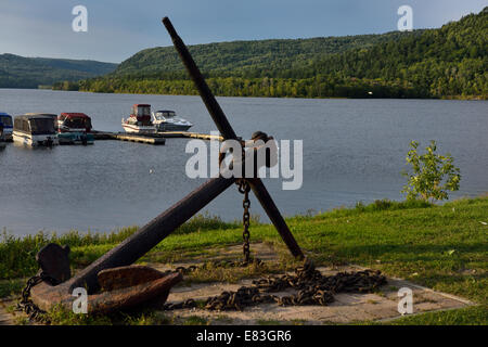 Rusted anchor and marina at Explorers Point Park Mattawa Northern Ontario with Quebec across the Ottawa river Ontario - Stock Photo