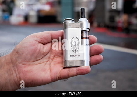 Man holding portable nicotine vaporizer - USA - Stock Photo