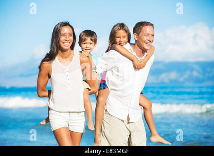 Happy Portrait of Mixed Race Family on the Beach - Stock Photo