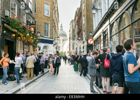 Office workers drinking after work outside pub in Watling Street, City of London, England, UK - Stock Photo