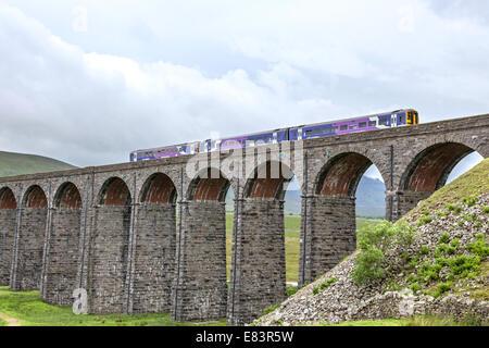 Train crossing the Ribblehead Viaduct on the Settle-Carlisle Railway line, North Yorkshire, England, UK