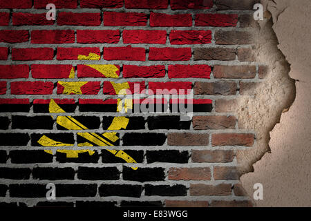 Dark brick wall texture with plaster - flag painted on wall - Angola - Stock Photo