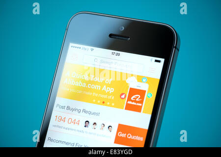 Close-up shot of brand new Apple iPhone 5S with Alibaba online store application on a screen. - Stock Photo