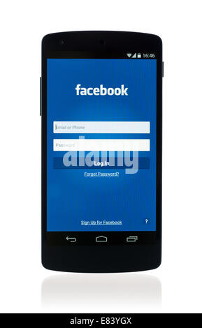 Studio shot of brand new Google Nexus 5, powered by Android 4.4 version, with Facebook mobile application on a screen. - Stock Photo