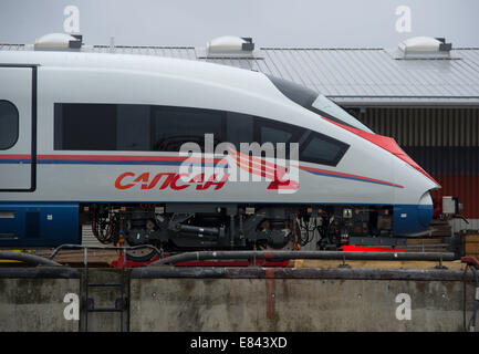 Ruegen, Germany. 30th Sep, 2014. A high-speed train for Russian railway company RZD is pictured at the ferry harbour - Stock Photo