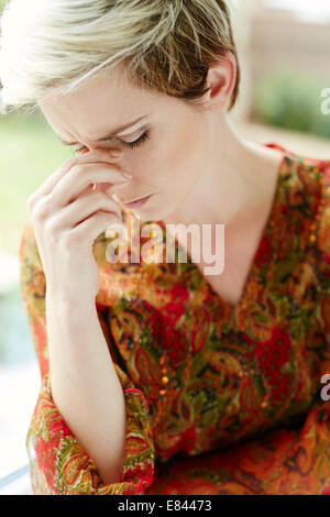 Girl with blocked sinuses - Stock Photo