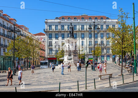 Luis de Camoes Square near the Chiado and Bairro Alto Districts with tourists sightseeing in a Summer day. Lisbon, - Stock Photo