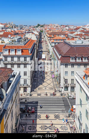 Aerial view of Rua Augusta Street in the Baixa District of Lisbon. The city most cosmopolitan street is always full - Stock Photo