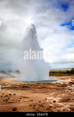 Eruption of Geysir - a large geyser in southwestern Iceland - Stock Photo