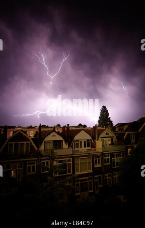 Thunderstorm with lightning over a town in The Netherlands, Europe. - Stock Photo