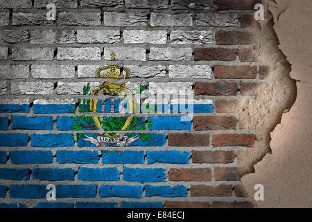 Dark brick wall texture with plaster - flag painted on wall - San Marino - Stock Photo
