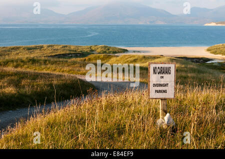 A sign beside Luskentyre Beach on the Isle of Harris prohibits camping or overnight parking. - Stock Photo