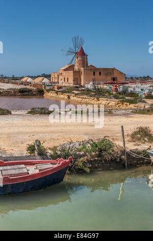 Saline with windmill and salt museum. The Salina Infersa located in Murana, Trapani, Sicily, Italy, Europe - Stock Photo