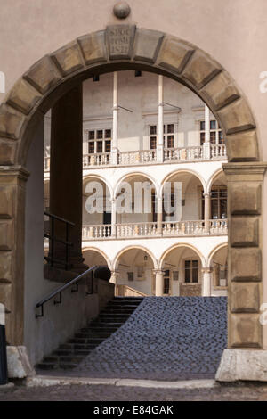 Archway to courtyard of Wawel Royal Castle on Wawel Hill, Krakow, Poland in September - Stock Photo