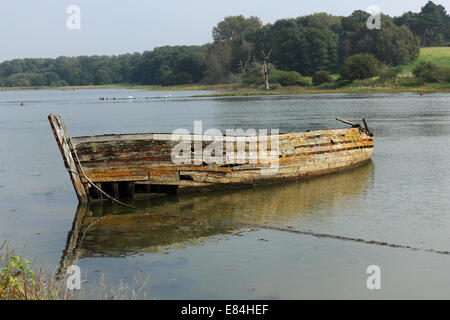 Boat wreck on the River Deben a  tidal estuary in Suffolk, UK - Stock Photo