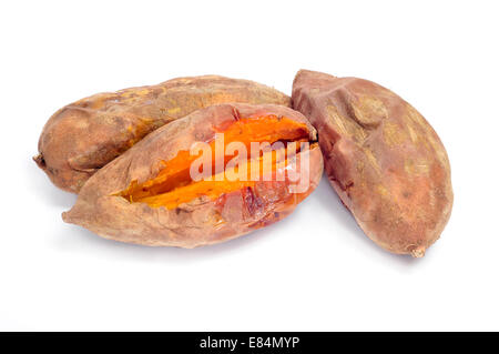 some roasted sweet potatoes on a white background - Stock Photo