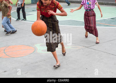 Indigenous children teenagers playing basketball, San Pedro, Lake Atitlan, Travel to Guatemala - Stock Photo
